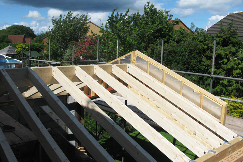 Single storey extension at Bradley Stoke. Detail of glulam timber roof structure