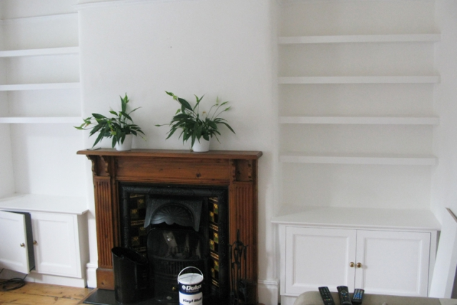 Floating shelves and fitted cupboards