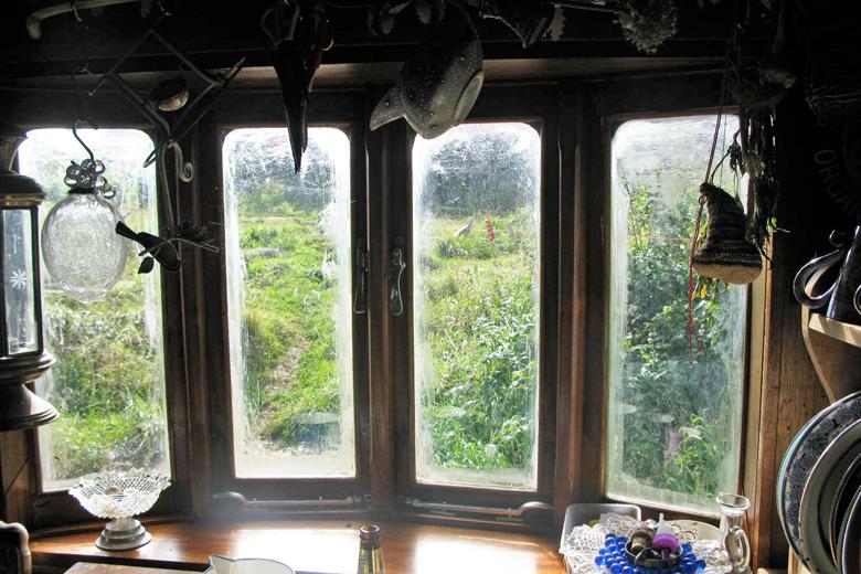 We rebuilt this showman's caravan window using traditional woodworking techniques