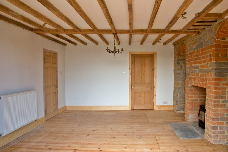 Somerset farmhouse renovation. Exposed oak beams, cleaned with linseed and bees wax