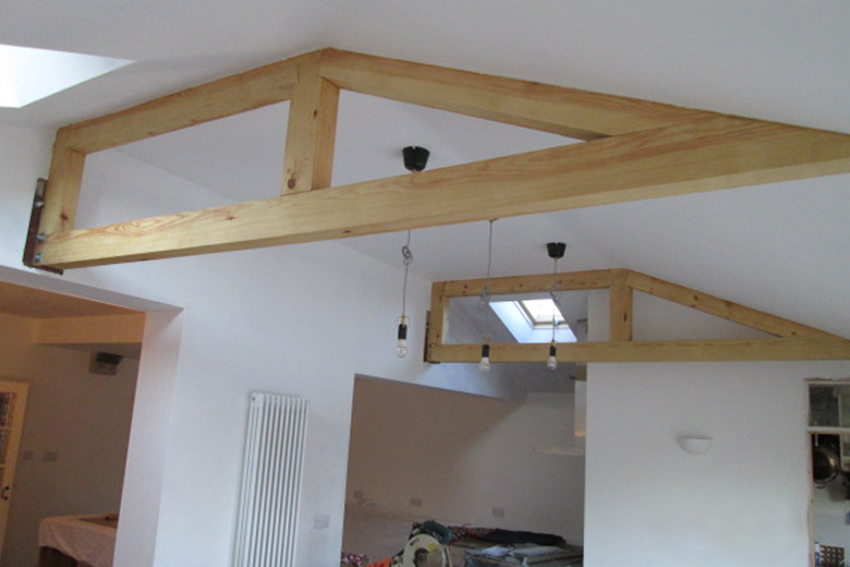 Hip roof extension with exposed trusses. Bishopston, Bristol